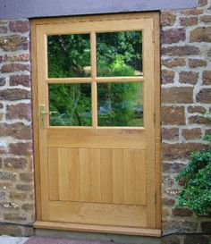 Solid oak door with bespoke viewing panels and matching half