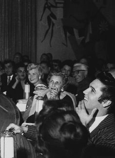 Elvis in the audience of Liberace's opening night concert at the Hotel Riviera in Las Vegas. Elvis was taking a few days off in Vegas, staying at the New Frontier Hotel.
