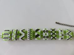 Hand woven bracelet in pearls Miyuki Delica Green and white on carrier beads (beads carrier) Beading Patterns Free, Beaded Bracelet Patterns, Beaded Rings, Beaded Bracelets, Seed Bead Jewelry, Loom Beading, Bead Art, Bead Weaving, Bracelets