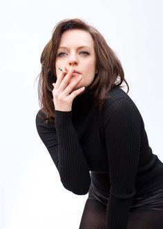 Elisabeth Moss smoking a cigarette (or weed)