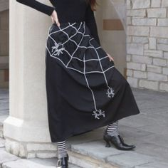 Spider Web Skirt - $49  Reviews suggest to dry clean & sizing is incorrect on website. Order size you wear regularly instead of on size chart.  Sizes: S-XL. Full skirt w/ 360 degrees of spiders & web, 100% polyester & elastic waistband.