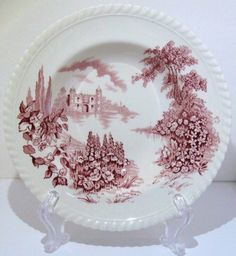 "johnson brothers ""castle on the lake""   i found a few of these pieces on one of my ""junkin'"" excursions and fell in love with it.  similar to ""old britain castles,"" it is a white china with a rope rim and depicts a castle overlooking a lake.  this pattern was only manufactured from 1939 through 1970, so pieces from this pattern are true collector's items, unlike ""old britain castles,"" which is still being made."
