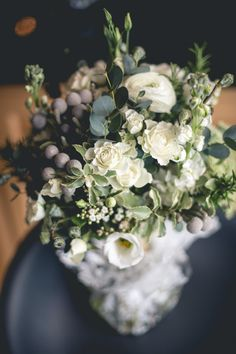 Gorgeous winter bouquet with eucalyptus. Christmas wedding at Nanteos Mansion by Whole Picture Weddings