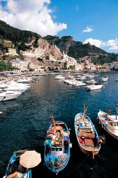 """Colorful boats line the marinas that dot the Amalfi Coast. Photo provided by GCCL traveler Roberto Soncin Gerometta. See this on the GCCL """"Tuscany & the Amalfi Coast"""" tour. For more information please visit http://www.gct.com/Trips/2013/Tuscany-and-the-Amalfi-Coast-2013.aspx #italy"""