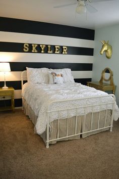 Tween Girl Room Makeover. Beautiful gold accents, unicorns, bold black & white stripes, light teal paint, and white bedding with polka dots/stripes.