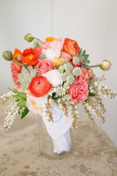 A sweet bridal bouquet with an antique kerchief wrapped around the stems.