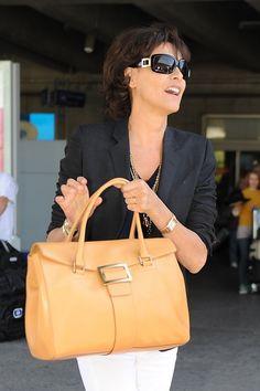 Ines de la Fressange. Chanel muse. She has such a Parisienne style.