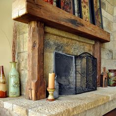 Fireplace with railroad ties and vertical pillars to define focal space of fireplace wall