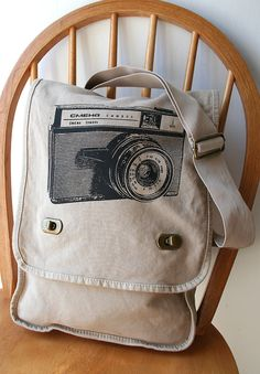 Etsy's CATBIRDCREATURES    Vintage Camera Field Bag Canvas Screen Printed   •••   measures 12 inches wide by 16 inches tall and 3 ½ inches deep, with an adjustable cotton webbing, strap   •••   @ 25.00 plus 4.00