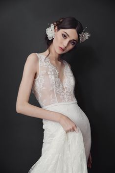 Fitted low back Chantilly gown, manually decorated with seed beads, Swarovski crystals and pearls. Lace Chapel train