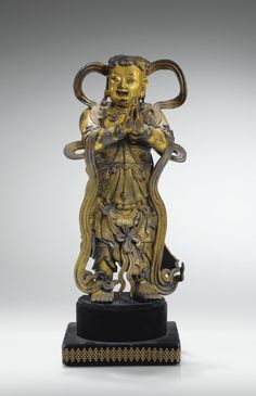 A GILT-BRONZE FIGURE OF THE ACOLYTE SUDHANA (attendant to quan yin), MING DYNASTY, 17TH CENTURY