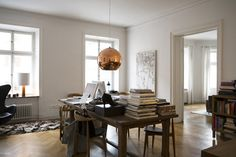 Single tom Dixon copper shade over dining table