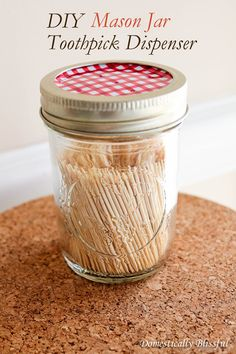 Use a hammer and nail to punch a few holes through a Mason jar's lid. Fill with toothpicks and shake to dispense a couple (and reduce the risk for a mini game of pick-up sticks). Get the tutorial at Domestically Blissful »  - GoodHousekeeping.com