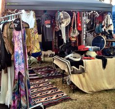 Classic Rock Couture, a very warm and inviting vintage pop-up shop. Native rugs, antlers, Christmas lights and many other craft booth ideas.