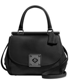 COACH Drifter Top Handle Satchel in Mixed Leather $495.00 A prominent COACH turnlock adds iconic edge to a shapely satchel cut from glovetanned and lightly textured leathers, while a removable strap contributes to its unique versatility and personal style statement.