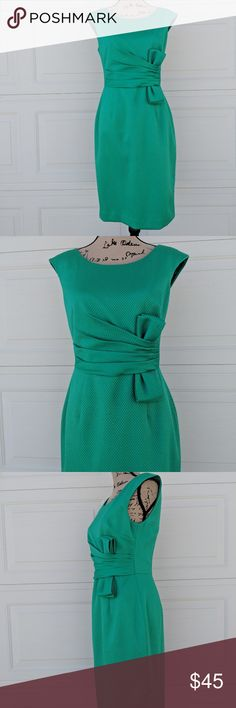 "Kay Unger Coctail Sheath Green Dress Bow Sheath 6 Never worn, new dress by Kay Unger.    97% cotton, 3% spandex. Lining 100% polyester.   Note: please note that the dress is not the exact same shade of green as on the photos, the camera could not capture the exact color. If you are looking for a specific shade of green, please let me know.    Approximate measurements:  Armpit to armpit across back 17.5"".  Shoulder to hem 37 1/4"".  Waist flat across   14"".  Kay Unger Dresses Mini"