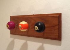 Coat hook,  I used the metal tube from golf clubs to extend the pool balls out.  Be very careful when drilling the holes in the balls. If they are old made of Bakelite because it heats up and WILL shatter.