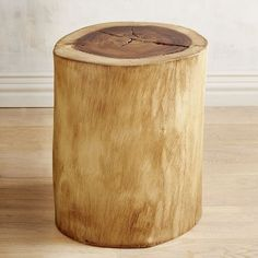 Our genuine acacia stump's natural grain and color warms up any room with eco-eclectic ruggedness. Use as a one-of-a-kind side or end table, or cluster two together to serve as a coffee table.