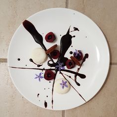 Cherry, Coconut Mousse, Chocolate Sable Breton, Dark Chocolate Sauce and Borage Flower