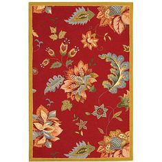 Add a jolt of brilliant color to your space with this hand-hooked wool rug that features a pretty botanical print on a field of red. This stylish rug is crafted from pure wool with a cotton backing and is thick and plush beneath bare feet.