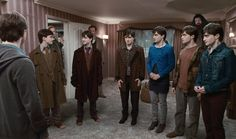 Harry Potter, Arthur Weasley, Remus Lupin and Rubeus Hagrid watch as Fred Weasley, George Weasley, Mundungus Fletcher, Fleur Delacour, Ron Weasley and Hermione Granger transform into Harry via Polyjuice Potion -