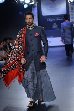 grey sherwani by . SAGAR TENALI