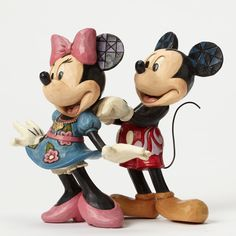 Title: Mickey & Minnie with Necklace Introduction: January 2015 Item Number: 4046042 Material: Stone Resin Dimensions: 5.71 in H x 5.31 in W x 5.51 in L Mickey delights Minnie with the gift of a JS ne