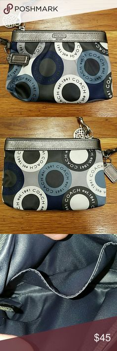 MORE RDUCED Nvr-used logo Coach logo wristlet Never used, near-pristine condition!  Unique, authentic Coach wristlet in funky discontinued optic print.  Made of beautiful satin-like material.  Lovely grey interior of same material.  Grey metallic leather detailing.  Extremely clean inside and out.  Two fun little Coach tags come attached.  Glad to provide more photos upon req. :) Coach Bags Clutches & Wristlets