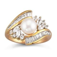 A gleaming pearl center surrounded by white sapphires gives this ring stunning elegance.