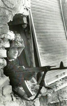 Member of the 8th SS Calvary Division Florian Geyer in Budapest with an MP44