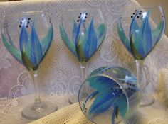 This set of four (4) large teardrop water/wine goblets are hand painted by Kathy. These glasses are 8 1/2 and hold 20 oz of your favorite beverage. The glasses are a STUNNING light blue and blue floral pattern with green leaves and black stamens that you will see when you tip the glass to drink. These are a an original design with Kathy dots and each glass is individually hand painted and signed by Kathy. (these are going to be worth a bundle one day, when they make it on Oprahs favorite…