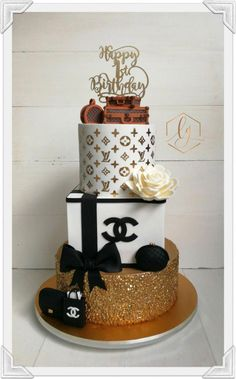 Made to celebrate a birthday, this three tier all cake creation was chic and elegant. Bottom tier was edible sequins painted gold, top tier stenciled and handmade LV trunks completes the cake. A single white sugar rose completes the cake. Chanel Birthday Cake, 19th Birthday Cakes, Sweet 16 Birthday Cake, Beautiful Birthday Cakes, Birthday Cakes For Women, Beautiful Cakes, 50th Birthday Cake Designs, 3 Tier Birthday Cake, Birthday Cake For Women Elegant