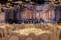 This ballroom setting was centered around creating a lush mixture of grand elements. In one moment the French inspired illustrations and wall details transport you