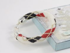 SIMPLY BEAUTIFUL Classic Bead Crochet Bracelet.  This minimalist Bead Crochet Bracelet is made of Japanese seed beads of superior quality - Miyuki: White, Red, Grey and Silver colors . BUSINESS OR PLEASURE. U will always say YES to this bracelet!  I am certain that the beauty of this piece will grow on you as time goes, and that you will wear it often, because I made it with love and did my best. BUY NOW, LOVE FOREVER!  The high quality silver plated findings are nickel free and lead free…