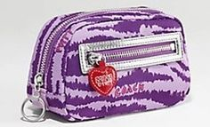 A little makeup bag with all my beauty essentials Coach Wristlet, Wristlet Wallet, Purple Accessories, Coach Poppy, Beauty Essentials, Shades Of Purple, Cosmetic Bag, Poppies, Suitcase