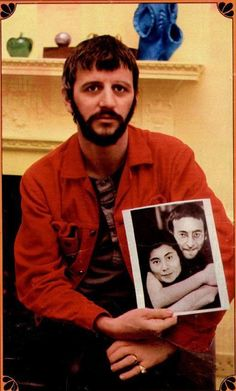 Ringo Starr, was looking at this photo and showed it to the camera looking as sad as he did when they broke up the Beatles. He has a 'bittersweet' look reminising about his beatle brother. Ringo Starr, Great Bands, Cool Bands, Good Music, My Music, Liverpool, Richard Starkey, The White Album, Love Me Do
