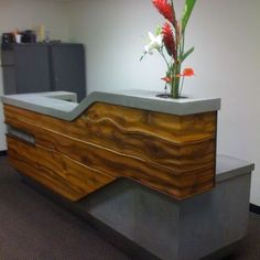 Greet your customers with a reception desk or reception counter handcrafted by expert artisans. Reception Counter Design, Office Reception Design, Modern Reception Desk, Office Table Design, Office Furniture Design, Office Interior Design, Office Interiors, Teak, Receptionist