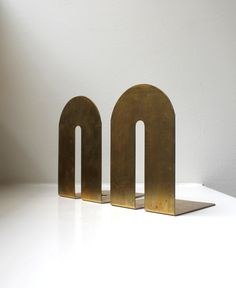 Mid Century Modern Polished Brass Arch Bookends