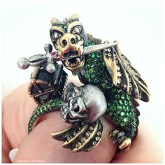 The Dragon and Knight Maneater ring by Wendy Brandes. With 4.5 cts of tsavorite garnets along with brown diamonds, white diamonds, rubies, and Kashi pearls.