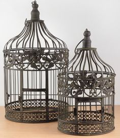 for guests to place their wedding cards.... Ivy & Eagle Decorated Metal Birdcage Set    $28 set