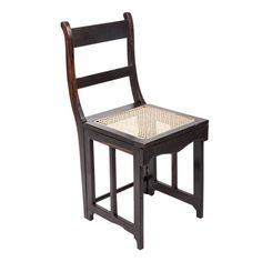 Anglo-Indian Ebony Folding Campaign Chair   Very unique Anglo-Indian solid ebony Campaign style folding chair. Chair folds flat for ease of transport or storage. Beautiful graining details in the wood. Newly caned seat. We have three pieces in total. From https://www.1stdibs.com/furniture/seating/chairs/  HEIGHT:34.5 in. (88 cm) WIDTH:15 in. (38 cm) DEPTH:18 in. (46 cm) SEAT HEIGHT:18 in. (46 cm)
