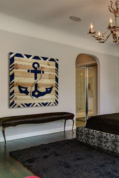 DIY idea for a large nautical wall decor piece. Anchor painted on wood panels.