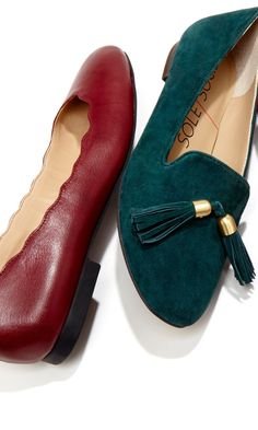 Luxurious suede loafer with tassel detail.