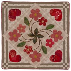 "Hearts & Flowers wall hanging, 36"" square, by Linda Jenkins & Becky Goldsmith (Piece O' Cake Designs).  Pattern at American Patchwork & Quilting. The hearts are created using a paper-pieced Log Cabin method."