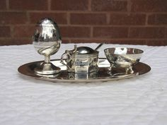 A very fine iraqi niello solid silver cruet set by the famous maker DAKEEL دخيل