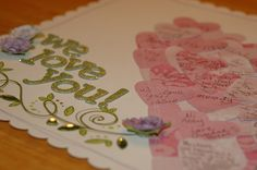 "Each guest signs a ""heart"" and glues it onto the scrapbook page for a Guest Sign In page for the book. (basic idea, other shapes are likely.)"