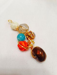 handmade beaded pendant/ cream, turquoise, orange, and brown beaded wire wrapped pendant on Etsy, $12.95