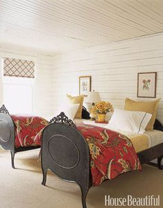 Designer Tom Stringer used antique French steel beds warmed by gold- and white-dotted quilts in this guest room. More: 101 Easy Home Makeover Ideas