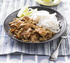 Chicken & cashew curry with coconut lime noodles. A super-speedy spicy chicken curry flavoured with garam masala and served with zesty rice noodles
