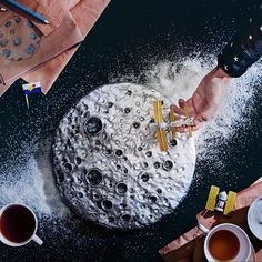 The same moon  #endlessbook #polymerclay #moon #cosmos #hands #outerspace #fromabove #stilllifeart #stilllife
